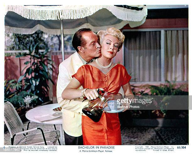 Bob Hope kissing the cheek of Lana Turner in a scene from the film 'Bachelor In Paradise' 1961