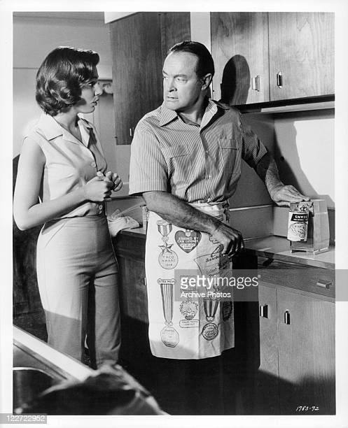 Bob Hope talks with Paula Prentiss while cooking in a scene from the film 'Bachelor In Paradise' 1961