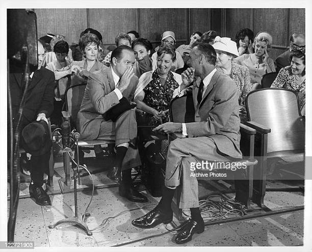 Bob Hope whispers to Jack Arnold in a scene from the film 'Bachelor In Paradise' 1961