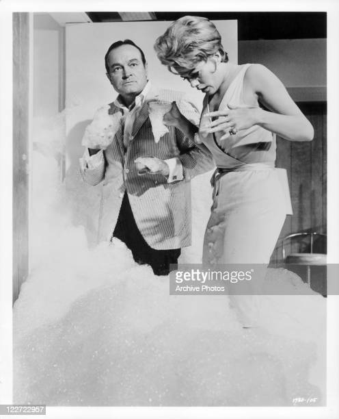 Bob Hope with Janis Paige standing in overflowing suds in a scene from the film 'Bachelor In Paradise' 1961
