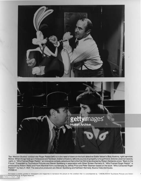 Bob Hoskins is chained to Roger Rabbit in a scene Bob Hoskins talks with Joanna Cassidy in a scene of the movie 'Who Framed Roger Rabbit' circa 1988