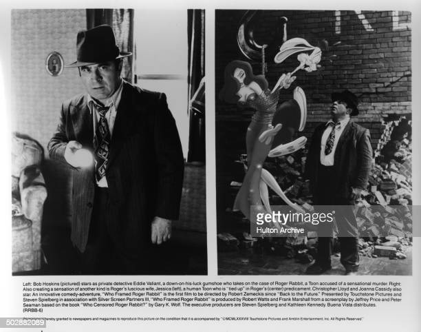 Bob Hoskins looks with a flashlight in a scene Jessica Rabbit Roger Rabbit are tied up as Bob Hoskins looks to help in a scene of the movie 'Who...