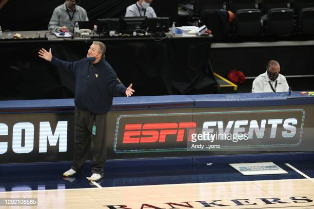 Bob Huggins the head coach of the West Virginia Mountaineers gives instructions to his team against the Gonzaga Bulldogs during the Jimmy V Classic...