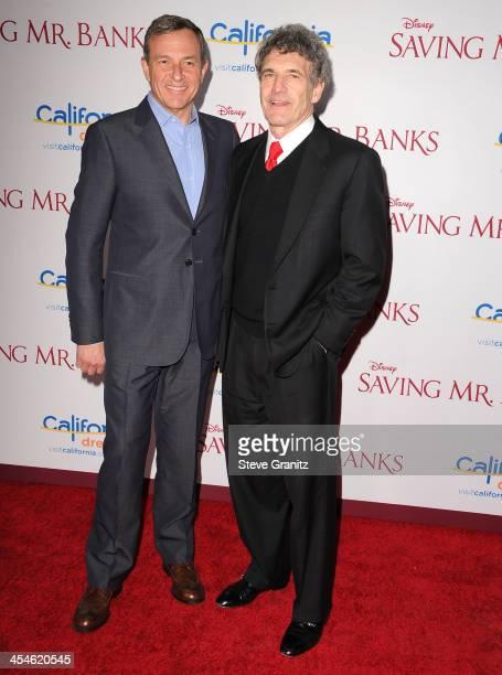 Bob Iger and Alan Horn arrives at the 'Saving Mr Banks' Los Angeles Premiere at Walt Disney Studios on December 9 2013 in Burbank California