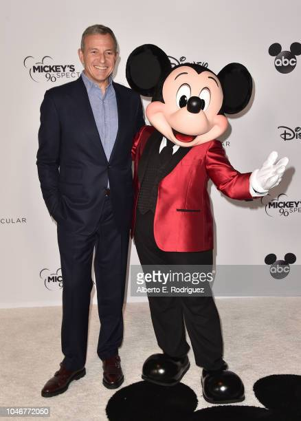 Bob Iger and Mickey Mouse attend Mickey's 90th Spectacular at The Shrine Auditorium on October 6 2018 in Los Angeles California