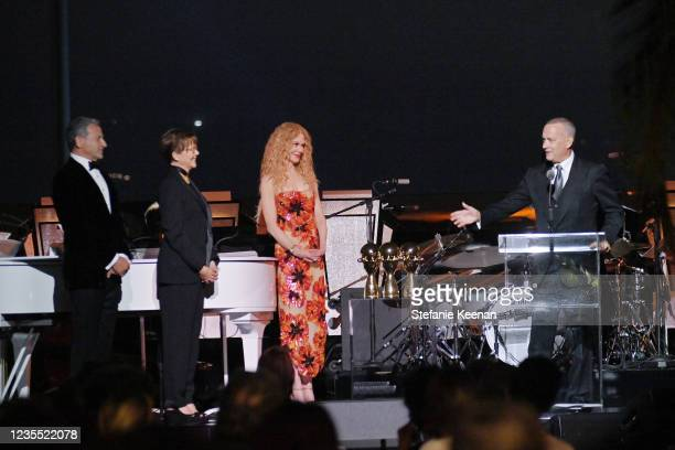 Bob Iger, Annette Bening, Nicole Kidman and Tom Hanks speak onstage during the Academy Museum of Motion Pictures: Opening Gala honoring Haile Gerima...