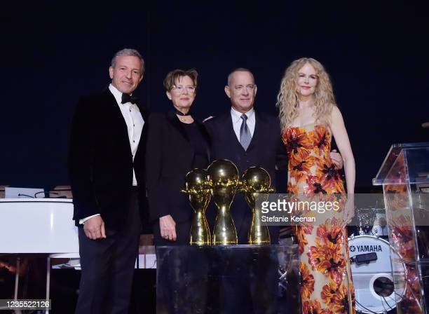 Bob Iger, Annette Bening, Tom Hanks and Nicole Kidman pose onstage during the Academy Museum of Motion Pictures: Opening Gala honoring Haile Gerima...