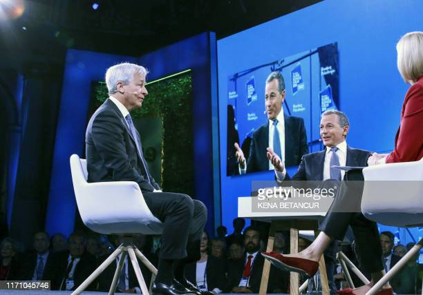Bob Iger Chairman and CEO of Walt Disney speaks next to Jamie Dimon Chairman CEO of JP Morgan Chase Co during the Bloomberg Global Business Forum in...
