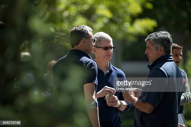 Bob Iger, chief executive officer of The Walt Disney Company, Tim Cook, chief executive officer of Apple Inc., and Eddy Cue, Apple senior vice...