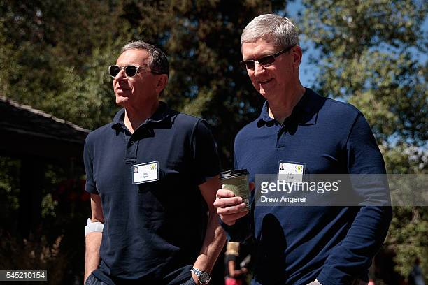 Bob Iger, chief executive officer of The Walt Disney Company, walks with Tim Cook, chief executive officer of Apple Inc., as they attend the annual...