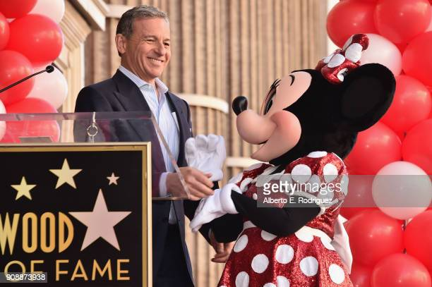Bob Igor Chairman and Chief Executive Officer The Walt Disney Company stands next to Minnie Mouse during a star ceremony in celebration of the 90th...