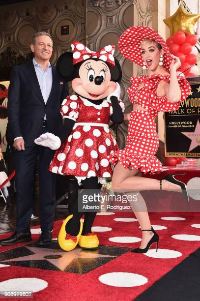 Bob Igor Chairman and Chief Executive Officer The Walt Disney Company and singer Katy Perry stand next to Minnie Mouse during a star ceremony in...