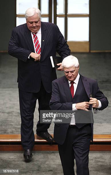 Bob Katter and Clive Palmer prepare to be sworn in during a swearing in ceremony in the House of Representatives chamber at Parliament House on...