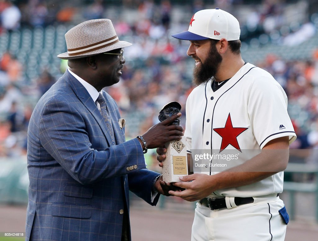 Bob Kendrick, president of the Negro Leagues Baseball Museum, presents Michael Fulmer #32 of the Detroit Tigers with the Larry Doby Legacy Award for American League Rookie of the Year before game two of a doubleheader against the Cleveland Indians at Comerica Park on July 1, 2017 in Detroit, Michigan.