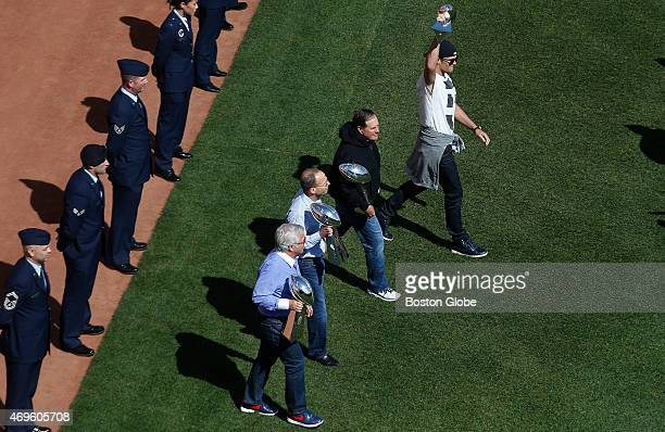 Bob Kraft Jonathan Kraft Bill Belichick and Tom Brady make their way out to the pitchers mound during the Red Sox home opener at Fenway Park in...