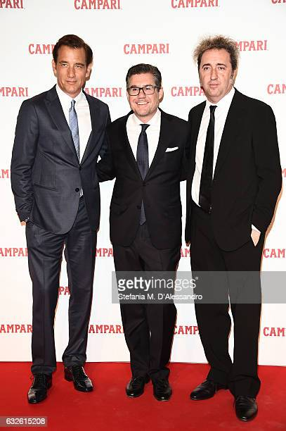 Bob KunzeConcewitz Clive Owen and Paolo Sorrentino walk the red carpet for 'Campari Red Diaries Killer In Red' on January 24 2017 in Rome Italy