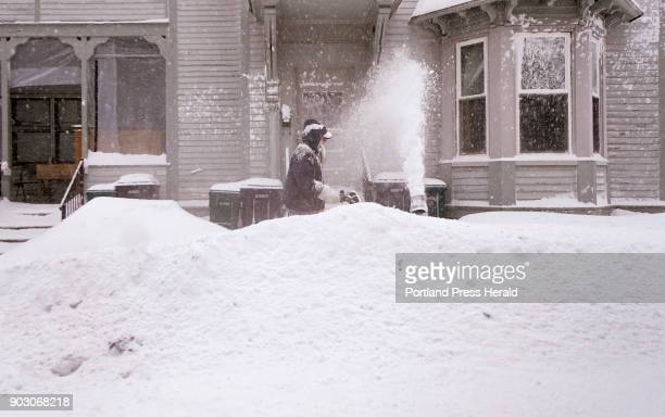 BIDDEFORD ME JANUARY 4 Bob Labbe clears snow with a snow blower from a sidewalk in front of his apartment building on Mt Vernon Street in Biddeford...
