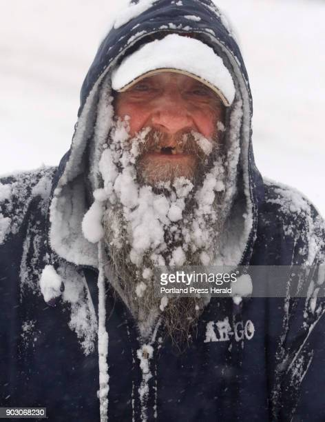 Bob Labbe's beard is coated with snow and ice while he clears snow with a snow blower from a sidewalk in front of his apartment building on Mt Vernon...