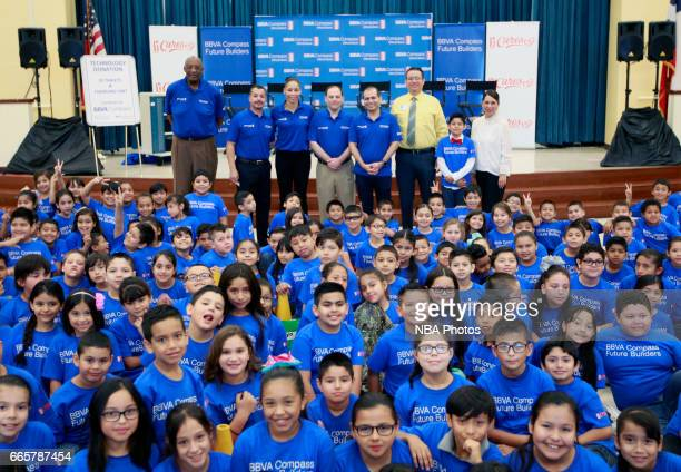 Bob Lanier left Jason Leal Allison Feaster Jon Rebello Rey Ocanas JA Gonzales Ramon Landeros and Rosey Guerra pose in front of students at Victor...