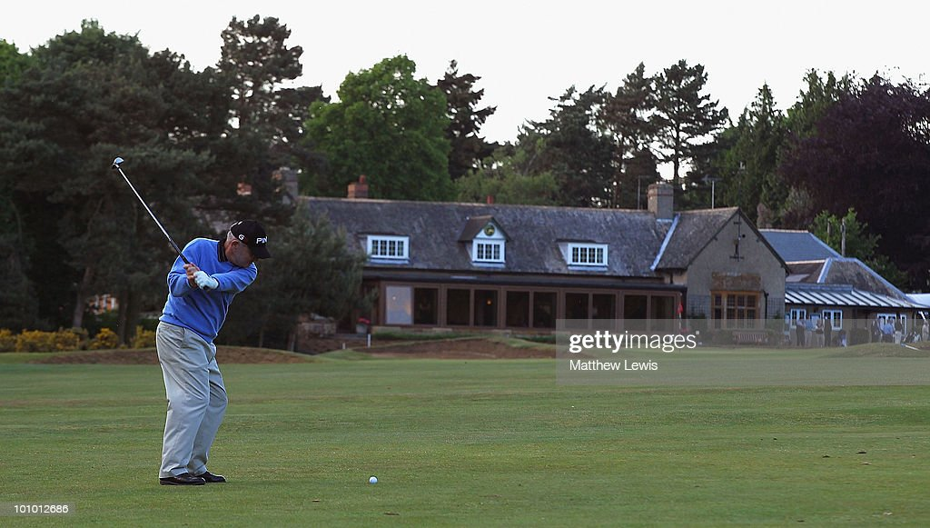 Bob Larratt of Kibworth plays a shot from the 18th fairway during the second round of the Senior PGA Professional Championship at Northamptonshire County Golf Club on May 27, 2010 in Northampton, England.