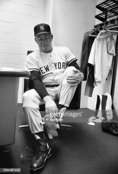 Bob Lemon, the new manager of the New York Yankees, puts on his new shoes in the visitors' locker room at the Royals Stadium.
