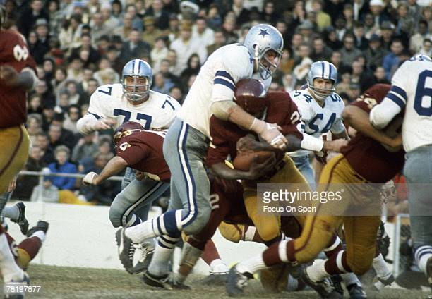 Bob Lilly of the Dallas Cowboys makes a tackle in a circa 1960's NFL game against the Washington Redskins at RFK stadium in Washington DC Lilly...