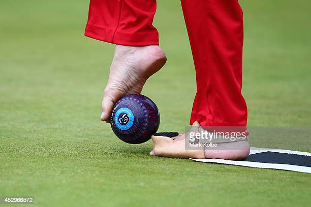 Bob Love of England prepares to bowl in the bronze medal Para-Sport Open Triples B6/B7/B8 lawn bowls match between England and Scotland at...