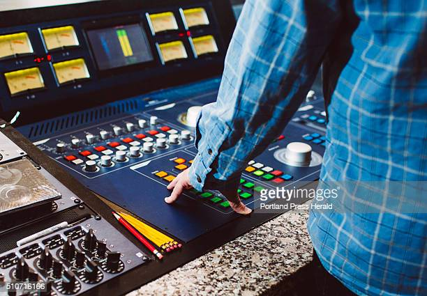 Bob Ludwig's hand on his audio equipment in his studio at Gateway Mastering in Portland ME on Friday January 29 2016