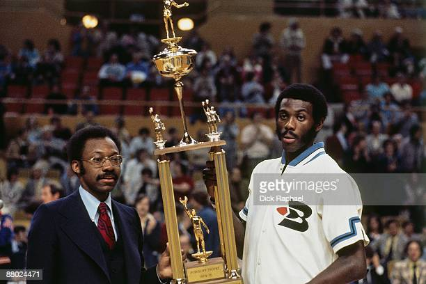 Bob MaAdoo of the Buffalo Braves receives the 1975 NBA's Most Valuable Player Award also known as the Podoloff Award during a game played in 1975 at...