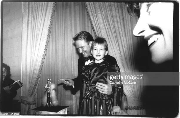 Bob Mackie poses for a photo with Anika Polzin a young girl from East Germany at 'A World of Imagination' Gala at WaldorfAstoria Hotel on February 12...
