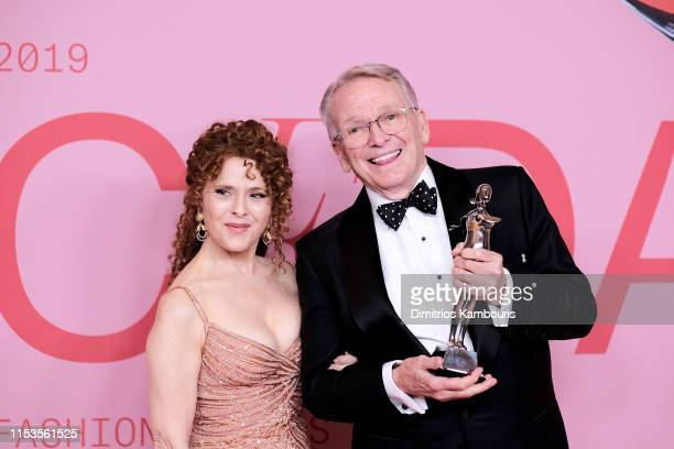 Bob Mackie poses with the Geoffrey Beene Lifetime Achievement Award and Bernadette Peters poses during Winners Walk during the CFDA Fashion Awards at...
