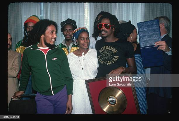 Bob Marley and Bunny Wailer receive a gold record for sales with their band the Wailers.