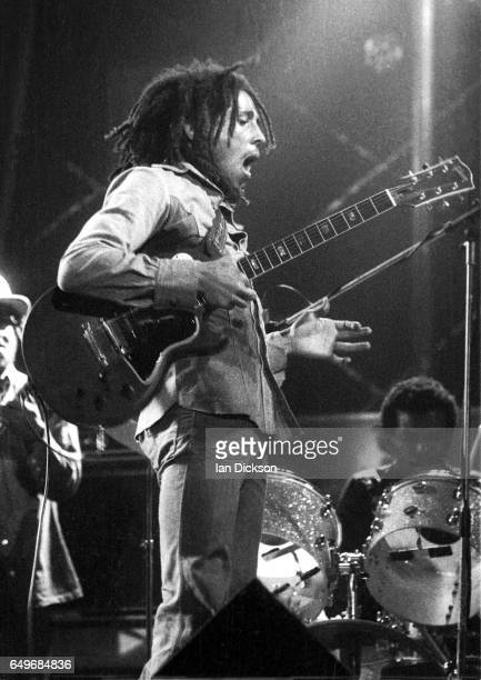 Bob Marley and Carlton Barrett of The Wailers perform on stage at the Odeon Birmingham United Kingdom 18 July 1975