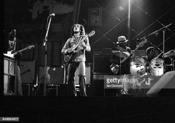 Bob Marley and The Wailers perform on stage at the Odeon Birmingham United Kingdom 18 July 1975 LR Al Anderson Bob Marley Aston 'Family Man' Barrett...