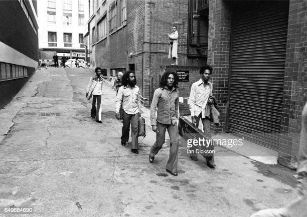 Bob Marley and The Wailers walk down an alley to the stage door behind the Odeon Birmingham United Kingdom 18 July 1975
