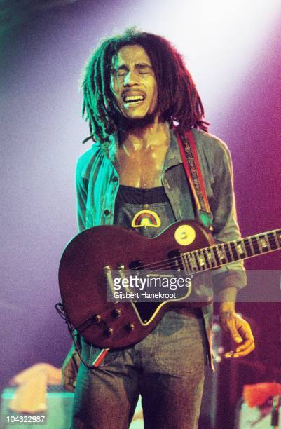 Bob Marley performs on stage with The Wailers at Houtrust Hallen on 13th May 1977 in The Hauge, Netherlands. He plays a Gibson Les Paul Special...