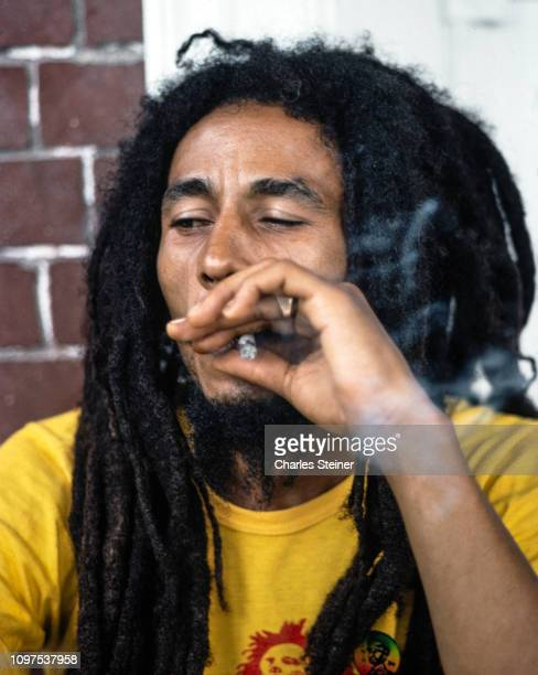 Bob Marley relaxes with friends in front of his house at 56 Hope Road on July 9 1970 in Kingston Jamaica