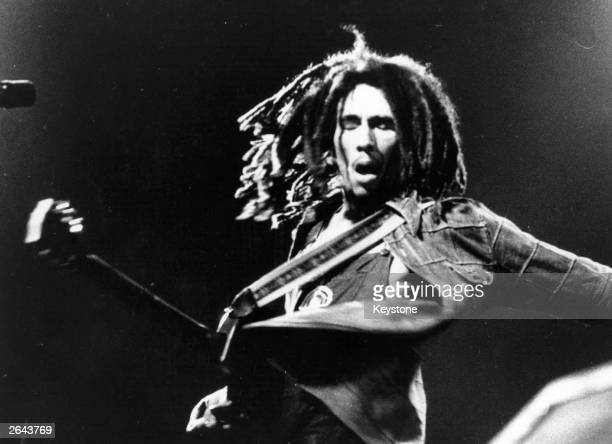 Bob Marley the Jamaican born singer, guitarist and composer in concert.