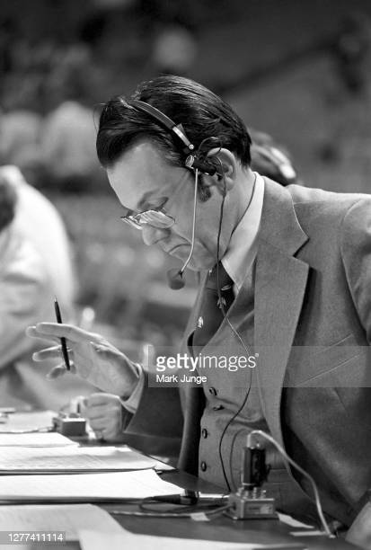 Bob Martin playbyplay radio announcer of the Denver Nuggets sitting at the media bench during a game against the Cleveland Cavaliers at McNichols...