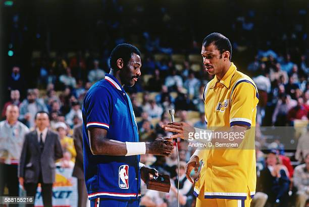 Bob McAdoo and Kareem AbdulJabbar of the Los Angeles Lakers speak during the 1985 ring ceremony circa 1985 at The Forum in Los Angeles California...