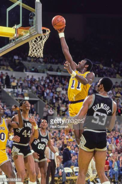 Bob McAdoo, Center and Power Forward for the Los Angeles Lakers jumps to make a lay up shot to the basket during the NBA Pacific Division basketball...