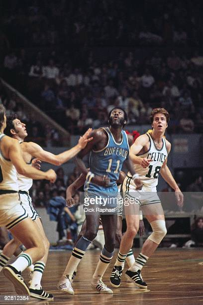 Bob McAdoo of the Buffalo Braves look to rebound against Dave Cowens of the Boston Celtics during a game played in 1974 at the Boston Garden in...