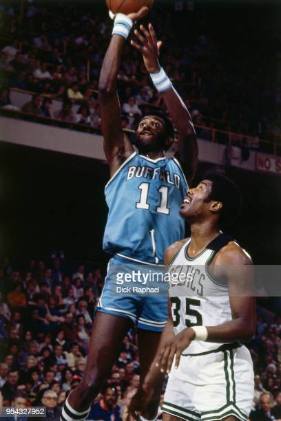 Bob McAdoo of the Buffalo Braves shoots the ball against the Boston Celtics circa 1974 at the Boston Garden in Boston Massachusetts NOTE TO USER User...