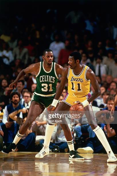 Bob McAdoo of the Los Angeles Lakers dribbles against Cedric Maxwell of the Boston Celtics during the 1985 NBA Finals circa 1985 at the Great Western...