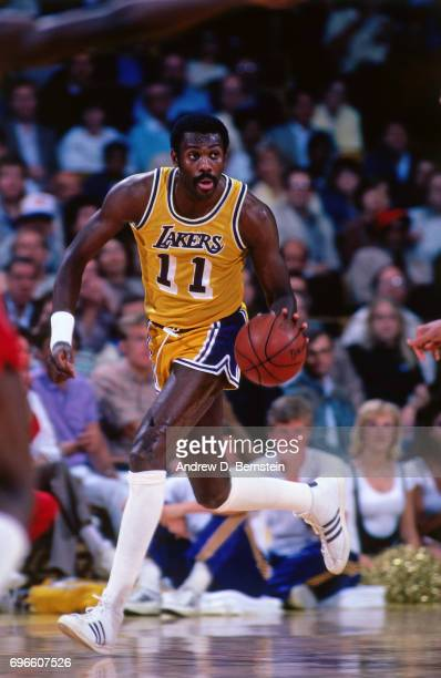 Bob McAdoo of the Los Angeles Lakers dribbles circa 1985 at the Great Western Forum in Inglewood California NOTE TO USER User expressly acknowledges...
