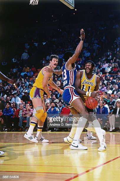 Bob McAdoo of the Los Angeles Lakers handles the ball against the Sacramento Kings during a game circa 1985 at The Forum in Los Angeles California...