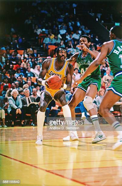 Bob McAdoo of the Los Angeles Lakers handles the ball against the Dallas Mavericks during a game circa 1987 at The Forum in Los Angeles California...