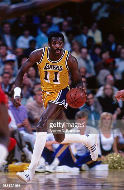 Bob McAdoo of the Los Angeles Lakers hanldes the ball during a game circa 1985 at The Forum in Los Angeles California NOTE TO USER User expressly...