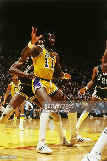 Bob McAdoo of the Los Angeles Lakers posts up against the San Antonio Spurs during a game circa 1988 at The Forum in Los Angeles California NOTE TO...