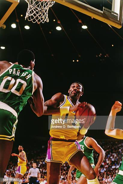 Bob McAdoo of the Los Angeles Lakers rebounds the ball against the Boston Celtics during a game circa 1987 at The Forum in Los Angeles California...